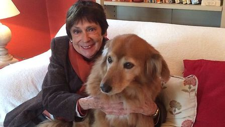 Annette, with her daughter's dog, Philos