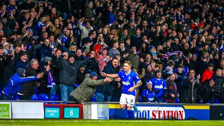 Martyn Waghorn celebrates with jubiliant Ipswich Town fans during the recent 4-2 victory against Not