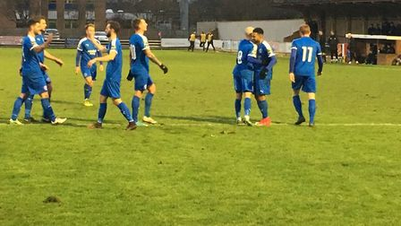 Leiston players celebrate their third goal, scored by Jack Ainsley, on the stroke of half-time at Ha