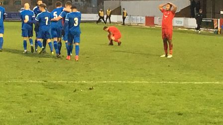 Harrow players (red shirts) look distraught as Leiston celebrate going 2-0 up on Saturday. Picture: