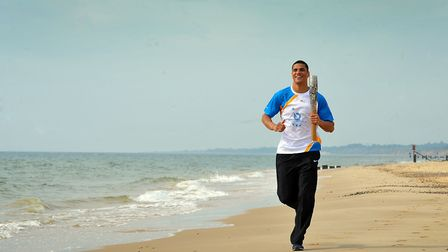Olympic legacy: Commonwealth Games Queen's Baton Relay – Anthony Ogogo carries the Baton along Lowes