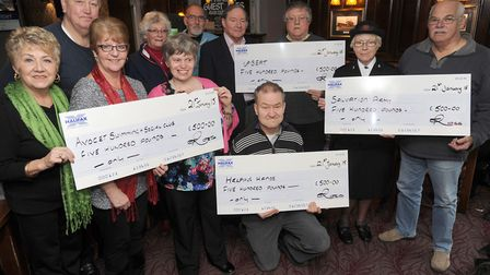 Sudbury car park dance committee hands over money raised from their 1960s recreation dance in 2015.