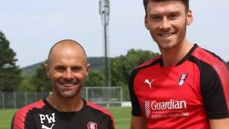 Kieffer Moore (right) and Rotherham boss Paul Warne: Picture: SHEFFIELD STAR