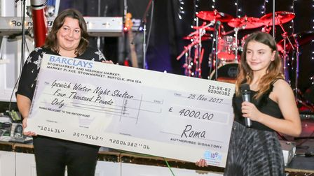 Roma presents £4,000 to Julia Hancock, business manager at Selig Suffolk, which runs the Ipswich win