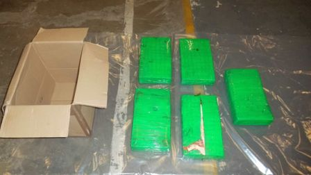 Five tape-wrapped packages were discovered in the trailer of a lorry coming into Harwich Internation