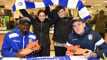 Colchester United first team players Sammie Szmodics and Oluwasanmi Odelusi pictured signing autogra
