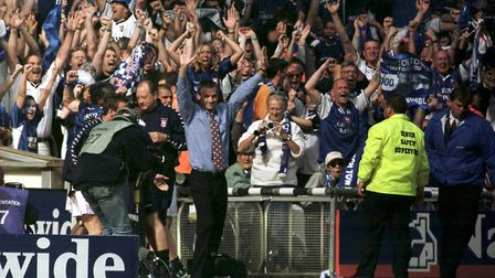 George Burley, Ipswich manager, celebrates at Wembley as Town reach the Premiership in May 2000. A y