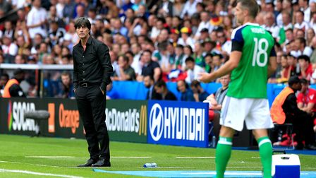 Germany manager Joachim Low (left) on the touchline at the Parc Des Princes, Paris. His players are
