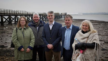 South Suffolk MP James Cartlidge, pictured with members of the Shotely Pier Group and community lead