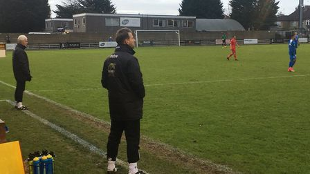 Leiston manager Glenn Driver, and coach Tony Kinsella, in the background, standing in the technical