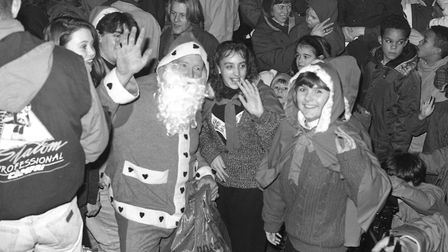 Father Christmas with some of those who turned out for Woodbridge's annual carol concert in 1990