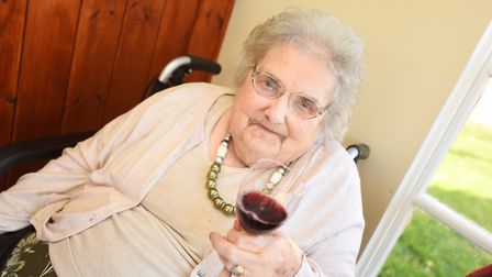 Chilton Meadows resident Daphne Hales enjoying a glass of wine. Picture: GREGG BROWN