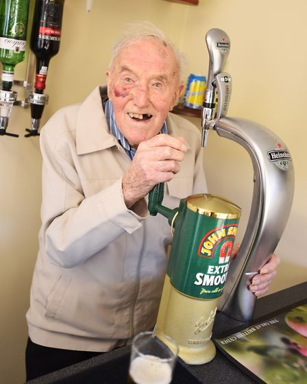 Pulling a pint in Chilton Meadows care home is Peter Gary. Picture: GREGG BROWN
