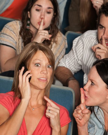 Loud woman on phone annoys people in theatre