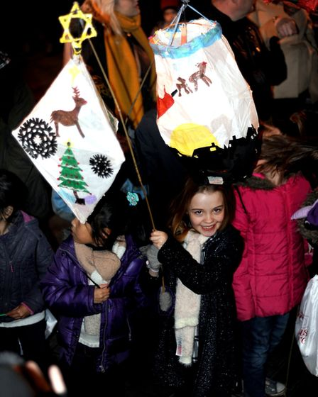 Schoolchildren lead the lantern parade from the Arc shopping centre to the Angel Hill to open the an