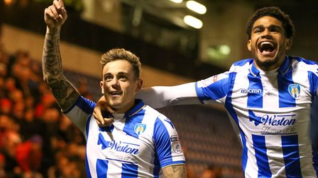 Two of Colchester United's young guns, Sammie Szmodics (left) celebrating his goal against Lincoln w