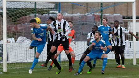 Leiston's Jack Ainsley attempts a glancing header from a Blues' corner. Photo: PAUL VOLLER