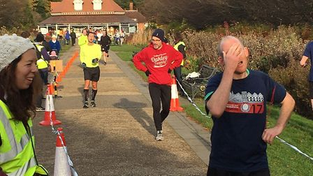 The relief at reaching the finish of the Bedford Parkrun, with the pavilion cafe in the background.