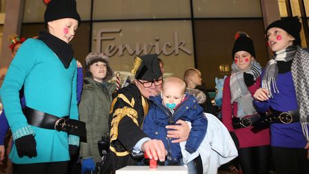 Mayor Gerard Oxford switches the lights on. Picture: SEANA HUGHES