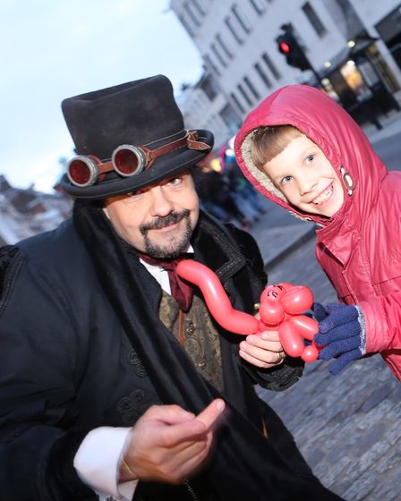 Riley English with street entertainer. Picture: SEANA HUGHES