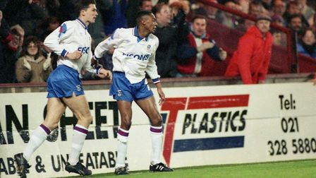 Ipswich Town forward Chris Kiwomya celebrates one of his goals with Eddie Youds in the 2-2 draw with