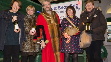 Beccles Town Mayor Richard Stubbings presents the awards for the best dressed window.Picture: Nick