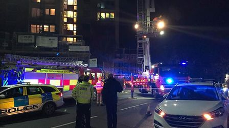 The aerial ladder platform is deployed by fire crews at the scene of a fire, which broke out on the