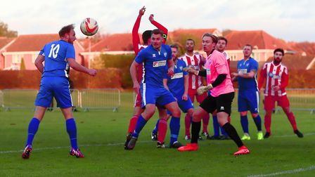 Joint Brantham player/manager Michael Brothers (10) in defensive duty as he heads behind to clear