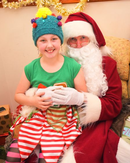 Grace Barfield with Father Christmas at RSPCA Christmas fair in Holbrook. Picture: GREGG BROWN