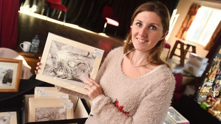 Artist Frances Vincent with her pencil drawings. Picture: GREGG BROWN