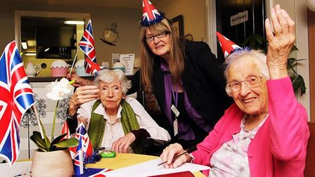 Tracie Thomson joins in the fun with residents, Evelyn Riordan (left) and Olive Unwin. Picture: PAU