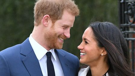 Prince Harry and Meghan Markle in the Sunken Garden at Kensington Palace after announcing their enga