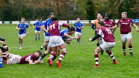 Diss, in blue and white, were tripped up late against Ruislip. Picture: JOHN GRIST