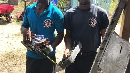 Residents on the island receive tools. Picture: CONTRIBUTED