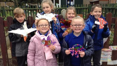 Pupils at Tattingstone Primary School proudly display some of the school's Beautiful Birds of Peace