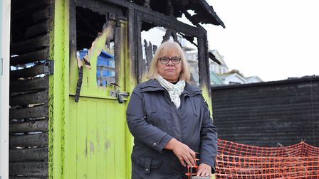 Noreen Stoker in front of the beach huts that have been set alight in Walton-on-the-Naze. Picture: