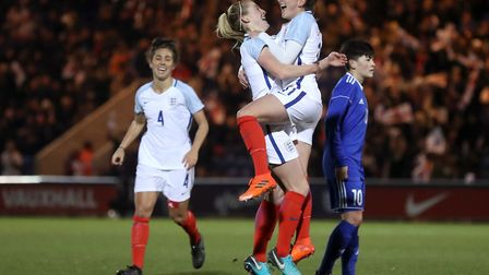 England's Melissa Lawley (right) celebrates scoring her side's first goal at Colchester. Picture: PA