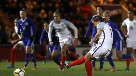 England's Fran Kirby scores her side's second goal of the game from the penalty spot. Picture: PA SP
