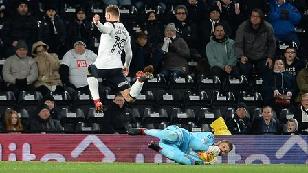 Bartosz Bialkowski saves at the feet of Andreas Weimar during the first half at Derby Picture Pagepi