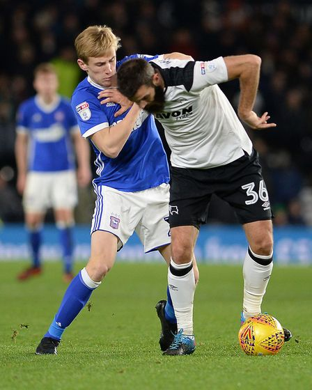 Flynn Downes tangles with Joe Ledley at Derby Picture Pagepix