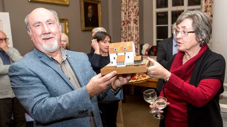 Nigel and Anne Barratt with their model of the tide mill. Picture: SIMON BALLARD