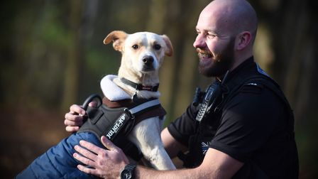 Buddy shows affection towards new owner PC Jon Harvey. Picture: GREGG BROWN