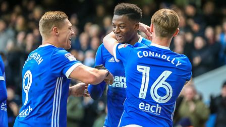 Dominic Iorfa (centre) celebrates with Martyn Waghorn and Callum Connolly after his goal put Town in