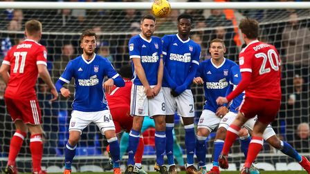 Kieran Dowell's free kick clears the Town wall as he scores to level at 1-1. Picture: STEVE WALLE