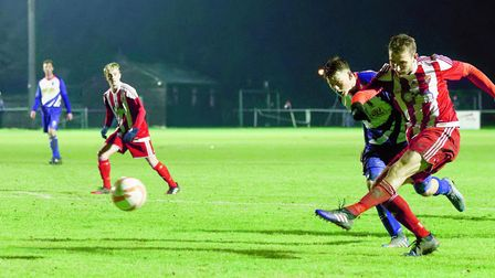 Felixstowe's Joe Francis shoots in their win over Clacton. Picture: STAN BASTON