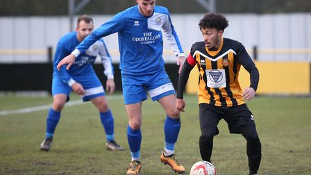 Stowmarket's Ollie Brown on the ball, watched by Kirkley's Jordan Haverson . Picture: RICHARD MARSHA