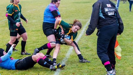 Bury's Danni Lee is forced into touch by Woodbridge's Tor Felstein. Picture: SIMON BALLARD