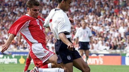 England's Kieron Dyer prepares to cross the ball to Alan Shearer for his hat-trick goal during the L