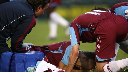 West Ham United's Kieron Dyer is carried off with a broken leg during the Carling Cup Smatch at the