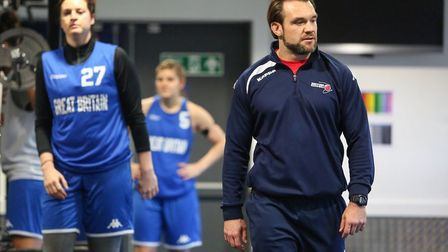 Mark Williams with members of the GB senior women's basketball team during training.